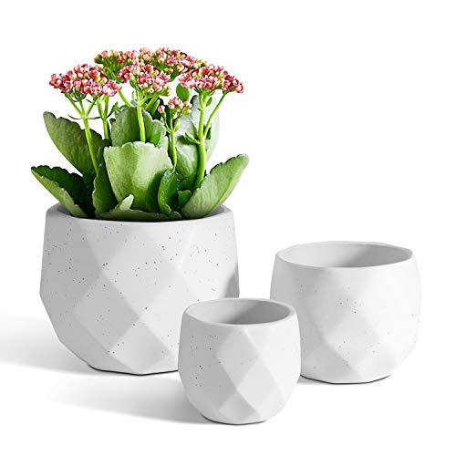 Conjunto de 3 maceteros de ceramica color blanco con diseño geometrico