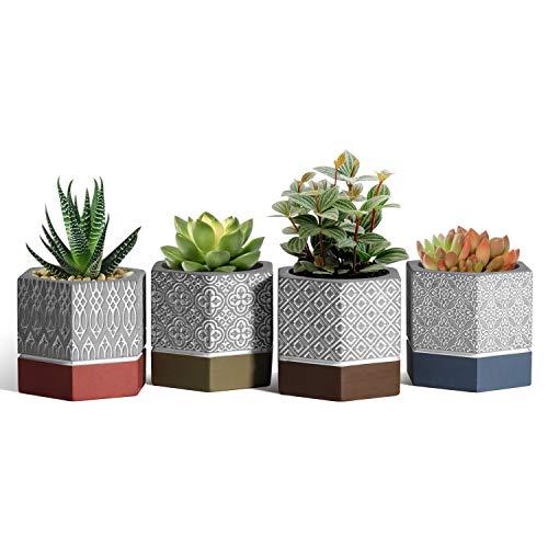 Conjunto de 4 Macetas de cemento decoradas con diseños geometricos a buen precio