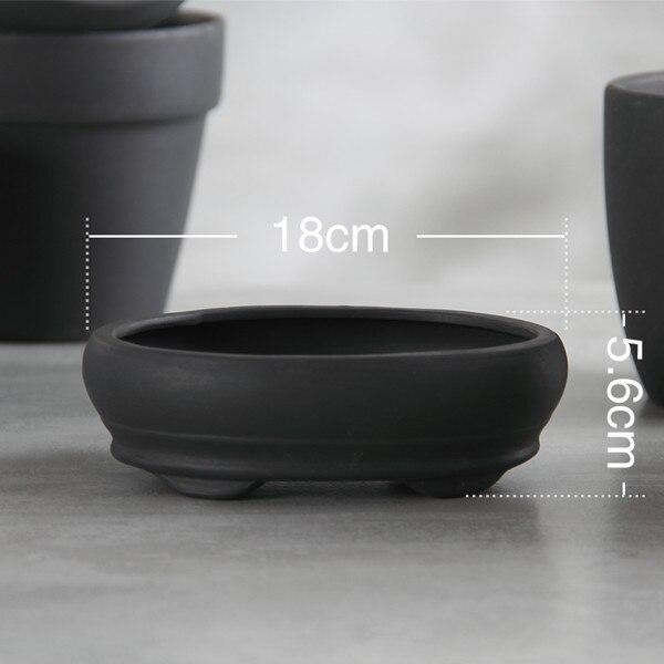 Maceta de terracota negra